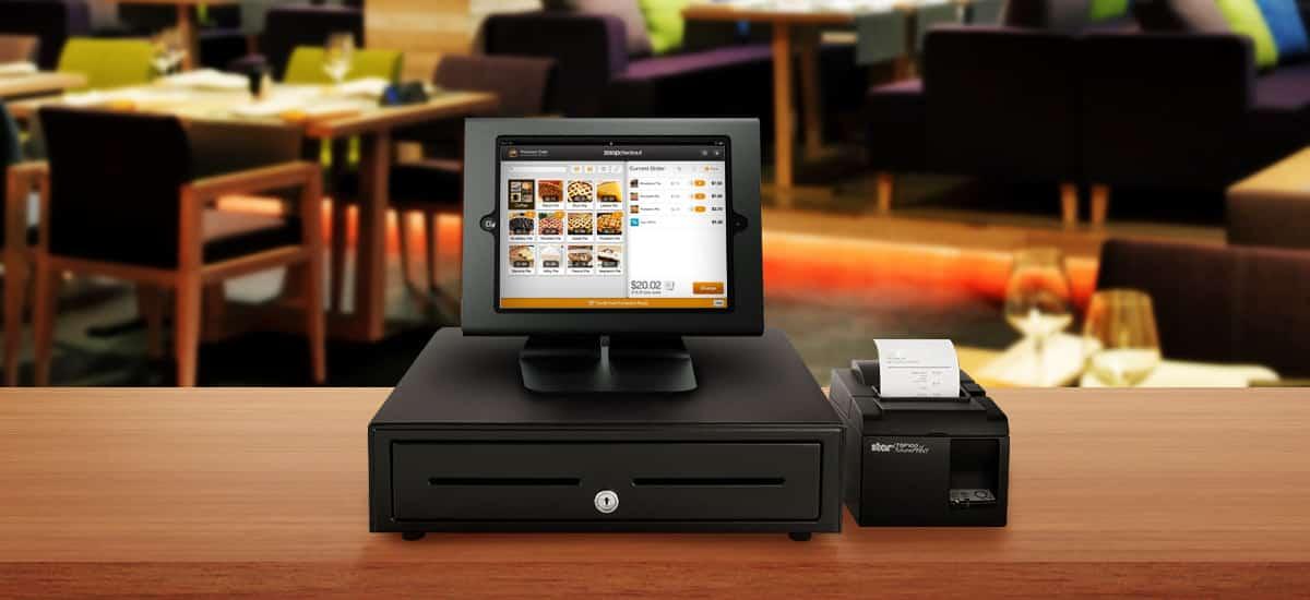 caixa registradora, tablet e impressora juntos usando Zoop Checkout como frente de caixa