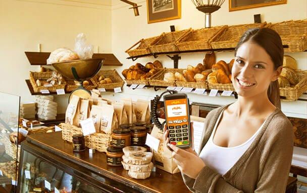 Mulher em padaria com máquina Rede com fio