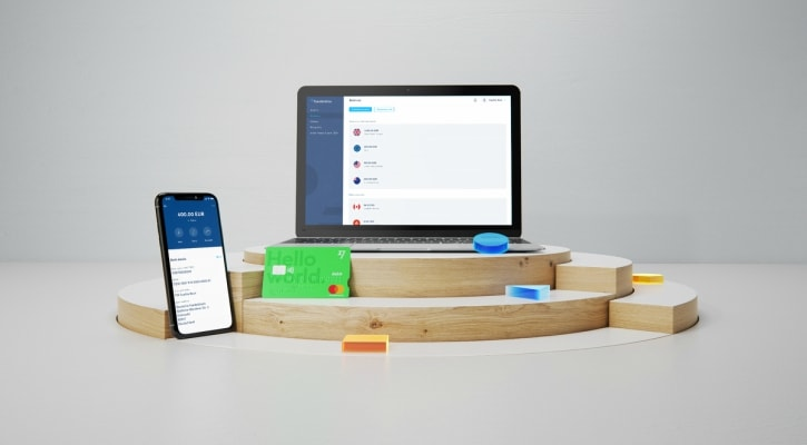 Ilsutração mostrando laptop e celular com o app Transferwire