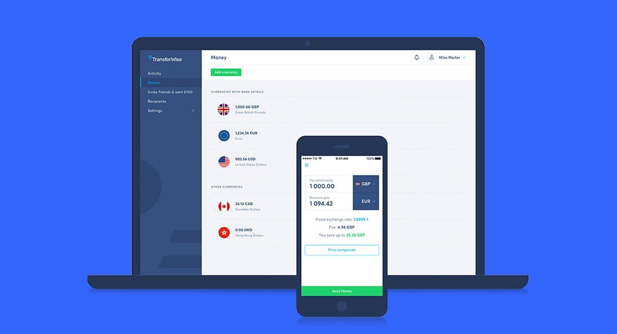 Laptop e Celular mostrando app TransferWise