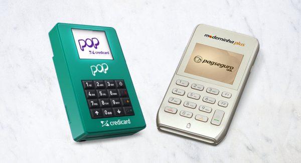Moderninha Pro e Pop Credicard sobre fundo mármore
