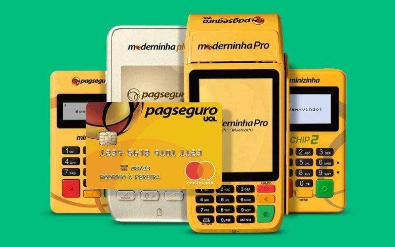 Máquinas de cartão com cartão pré-pago PagSeguro em fundo verde