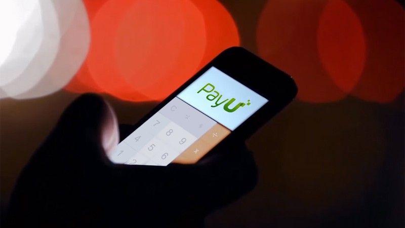 Ilustração mostrando pessoa usando PayU pelo celular