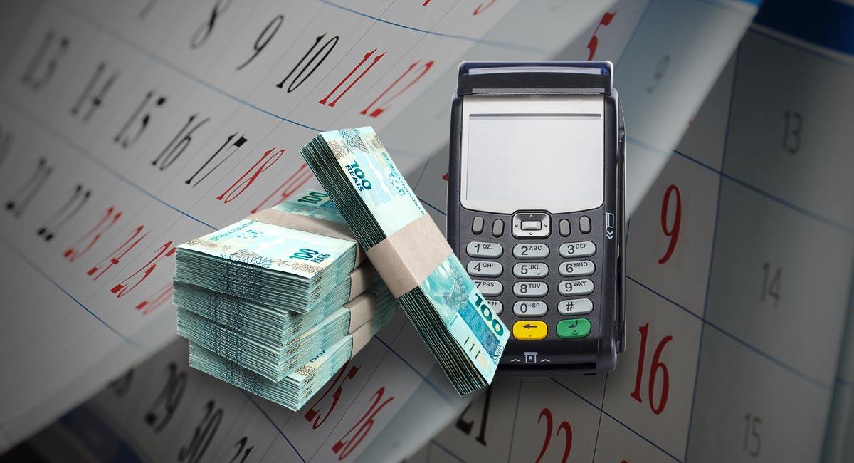 Máquian de cartão ao lago de bolos de notas de dinheiro cobre fundo mostrando calendário