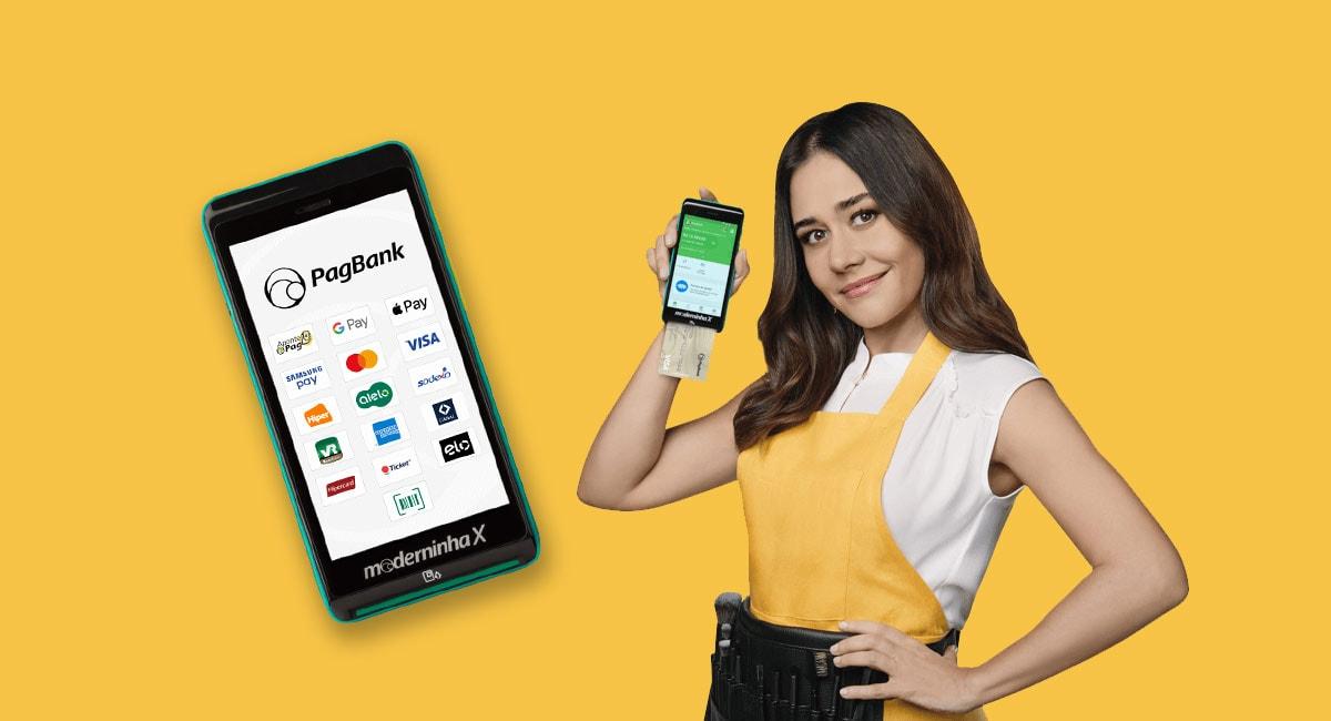 Maquininha de cartão Moderninha X mostrando logo PagBank e formas de pagamento ao lado da atriz Alessandra Negrini