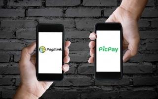 Dois celulares com as logos do PicPay e PagBank
