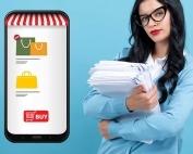 Mulher segurando pilha de papeis ao lado de celular com loja virtual