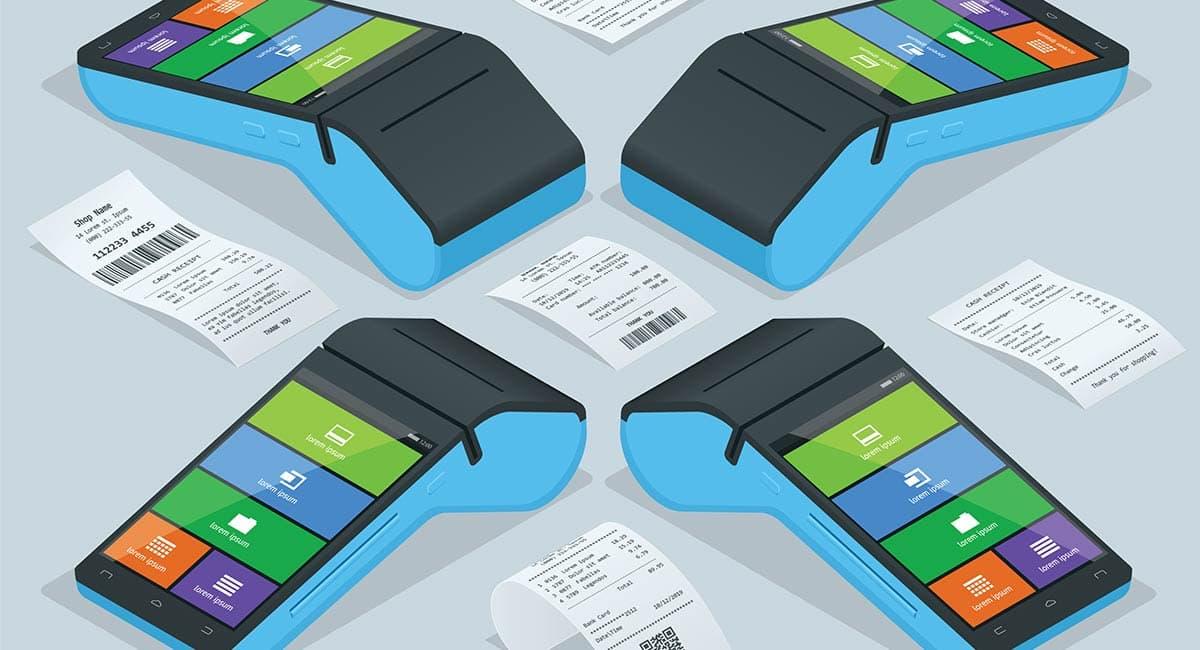 Notas fiscais ao lado de máquina de cartão